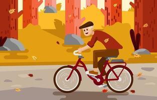 attività in bici nella stagione autunnale vettore