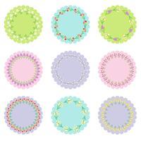 etichette circolari con cornici floreali vettore