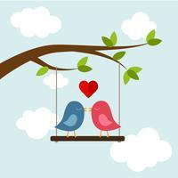 Due uccelli innamorati sull'albero