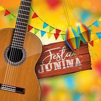 Illustrazione di Festa Junina con la chitarra acustica, le bandiere del partito e la lanterna di carta su fondo giallo. Tipografia su tavolo in legno d'epoca. Vector Brasile giugno Festival Design