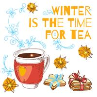 Legato con una tazza di tè caldo e biscotti a forma di stella con un nastro blu