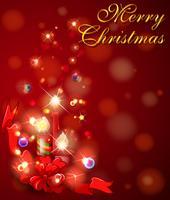 Cartolina di Natale allegra con le candele su priorità bassa rossa