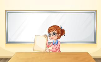Un insegnante davanti alla lavagna con in mano un modello vuoto vettore