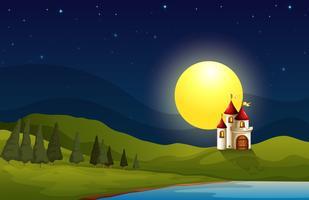 Un castello sulla collina sotto una luna luminosa vettore