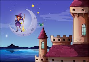 Una strega con un manico di scopa in piedi vicino al castello vettore