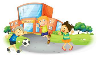 Bambini che giocano a calcio a scuola vettore