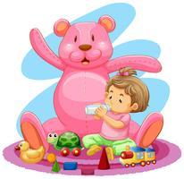 Ragazzino e molti giocattoli sul pavimento
