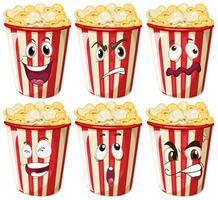 Diverse espressioni facciali su tazze di popcorn