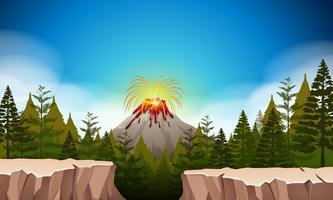 Scena della natura con l'eruzione del vulcano vettore
