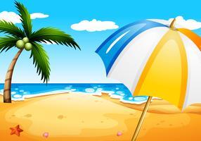 Una spiaggia con un ombrello vettore