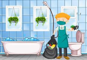 Bidello maschio che pulisce la toilette