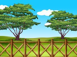 Un bellissimo paesaggio con una recinzione vettore