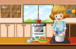 Donna che cucina in cucina vettore