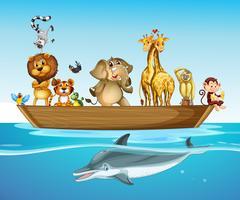 Animali selvatici sulla barca in mare vettore