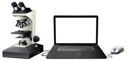 Microscopio digitale del computer su fondo bianco