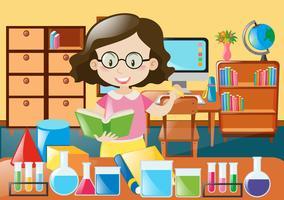 Insegnante con libri e attrezzature scientifiche