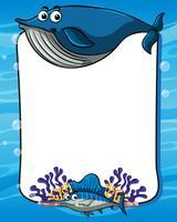 Modello di cornice con balena blu