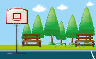 Scena del parco con campo da basket