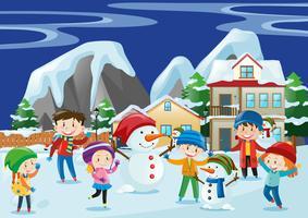 Bambini che giocano a neve in inverno vettore