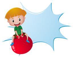 Modello di splash con ragazzo sulla palla rossa