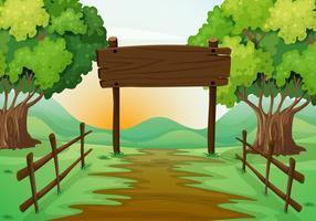 Scena con campo e cartello in legno
