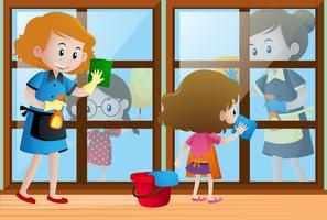 Bambini che aiutano i pulitori a pulire le finestre