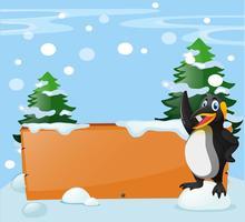 Modello di bordo con pinguino nella neve vettore