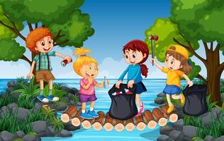 Bambini che raccolgono rifiuti vicino al fiume vettore