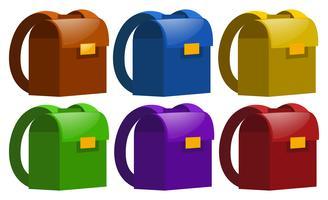 Zaini scolastici in sei colori vettore