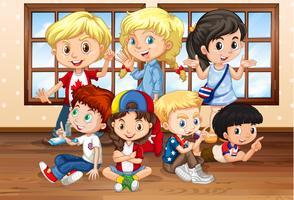 Molti bambini in classe vettore