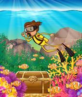 Immersione subacquea dell'uomo sotto l'oceano