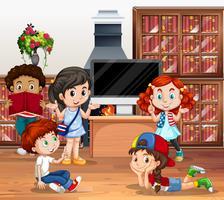 Un sacco di bambini che leggono il libro in biblioteca vettore