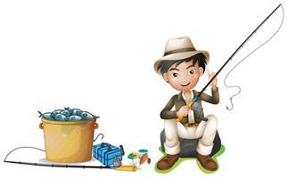 Uomo con canna da pesca e secchio di pesce