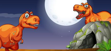 Due T-Rex vicino alla grotta di notte