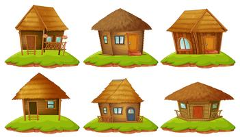 Diversi disegni di cottage in legno vettore