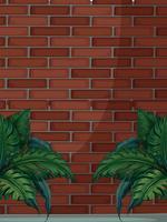 Muro di mattoni con foglie verdi vettore