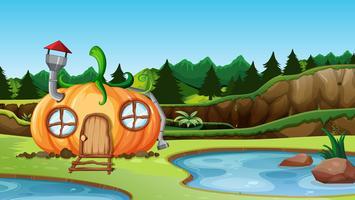 Casa di zucca nel paesaggio della natura vettore