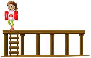Una bandiera canadese della holding della ragazza vettore