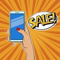 Mano della donna che tiene smartphone e vendita di descrizione.