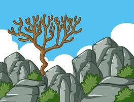 Scena con albero e rocce vettore