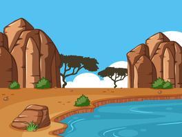 Scena con canyon e pozza d'acqua vettore