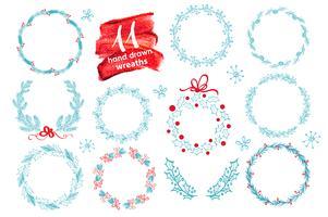 La corona disegnata a mano di Natale ha messo con l'inverno floreale. Illustrazione vettoriale Cartolina d'auguri di stagione. Per il tuo testo, lettering, calligrafia