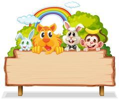 Molti animali su tavola di legno vettore