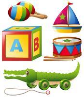 Diversi tipi di giocattoli nel set vettore
