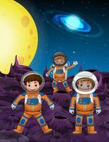 Tre astronauti sulla superficie della luna vettore
