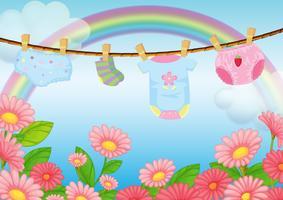 Vestiti da neonato vicino al giardino vettore
