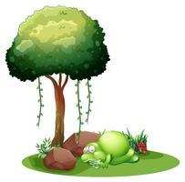 Un mostro che dorme sotto l'albero vettore