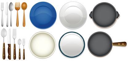 Un set di utensili da cucina su sfondo bianco vettore