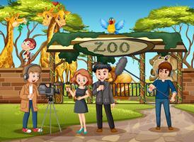 Un'intervista all'aperto allo zoo vettore
