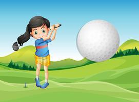 Una giovane donna che gioca a golf